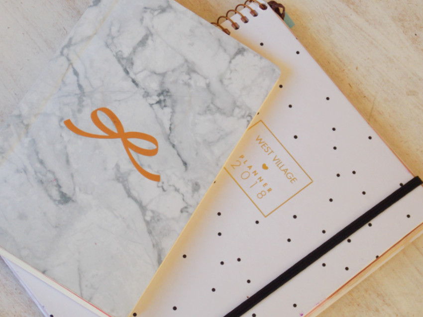 A monthly planner and the notebook that became my bullet journal.