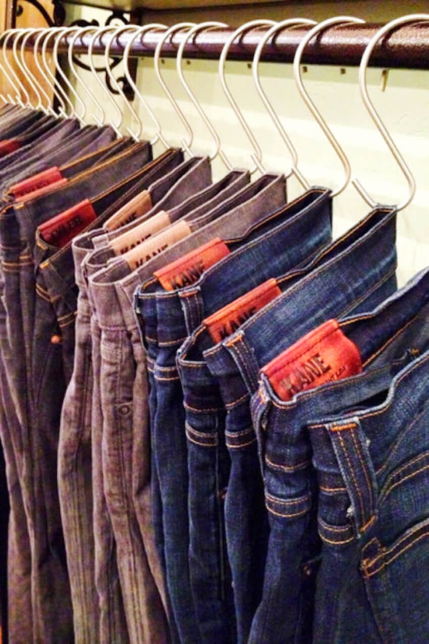Hanging pants with hooks will save space in your closet.