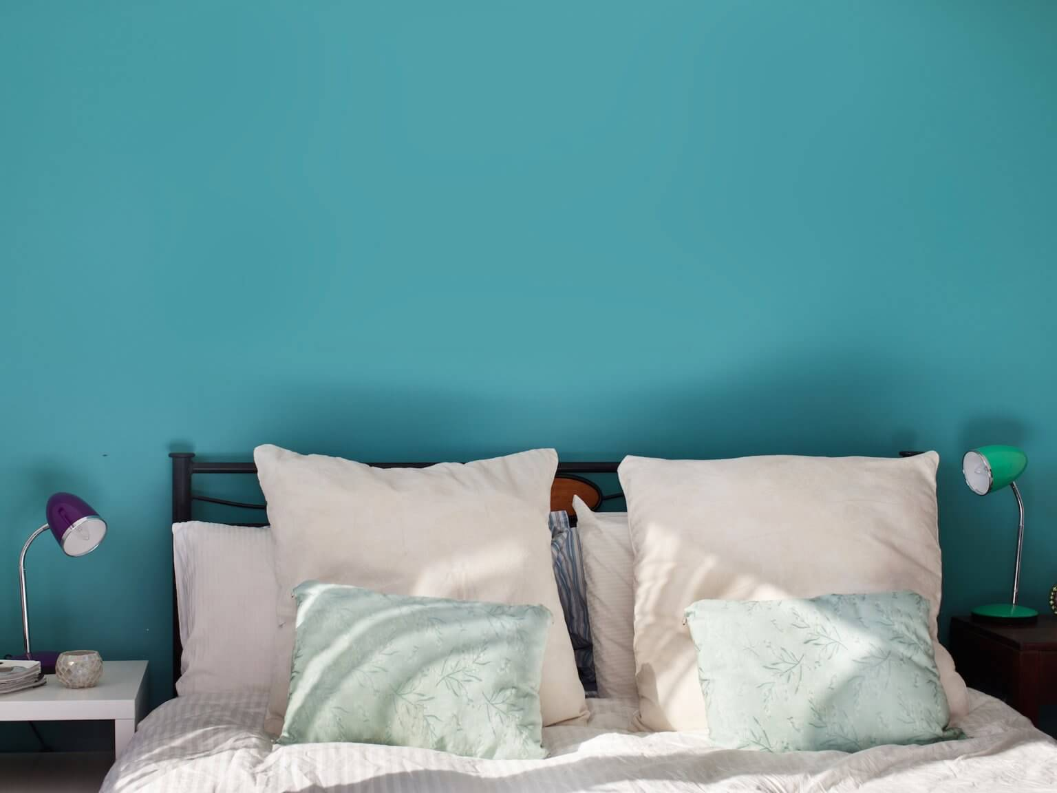 Blue walls match blue bedding
