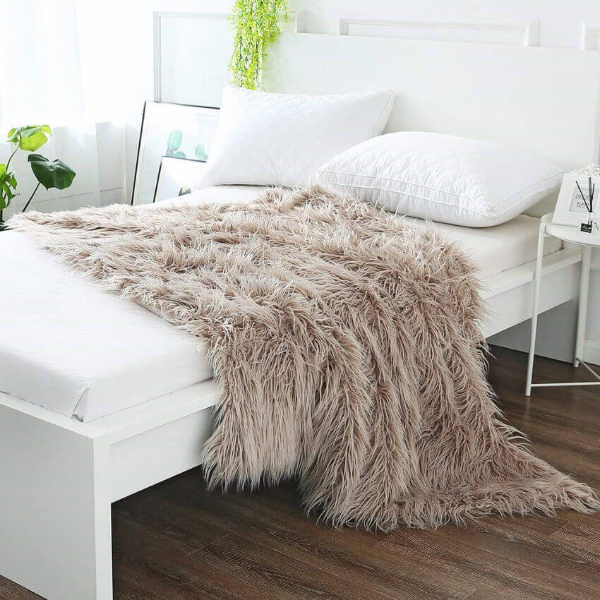 A faux fur blanket is just inviting you to get cozy.