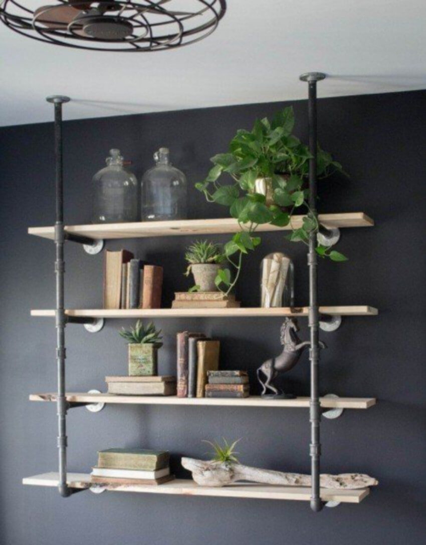 Pipe shelves are a quintessential part of the industrial decor style.