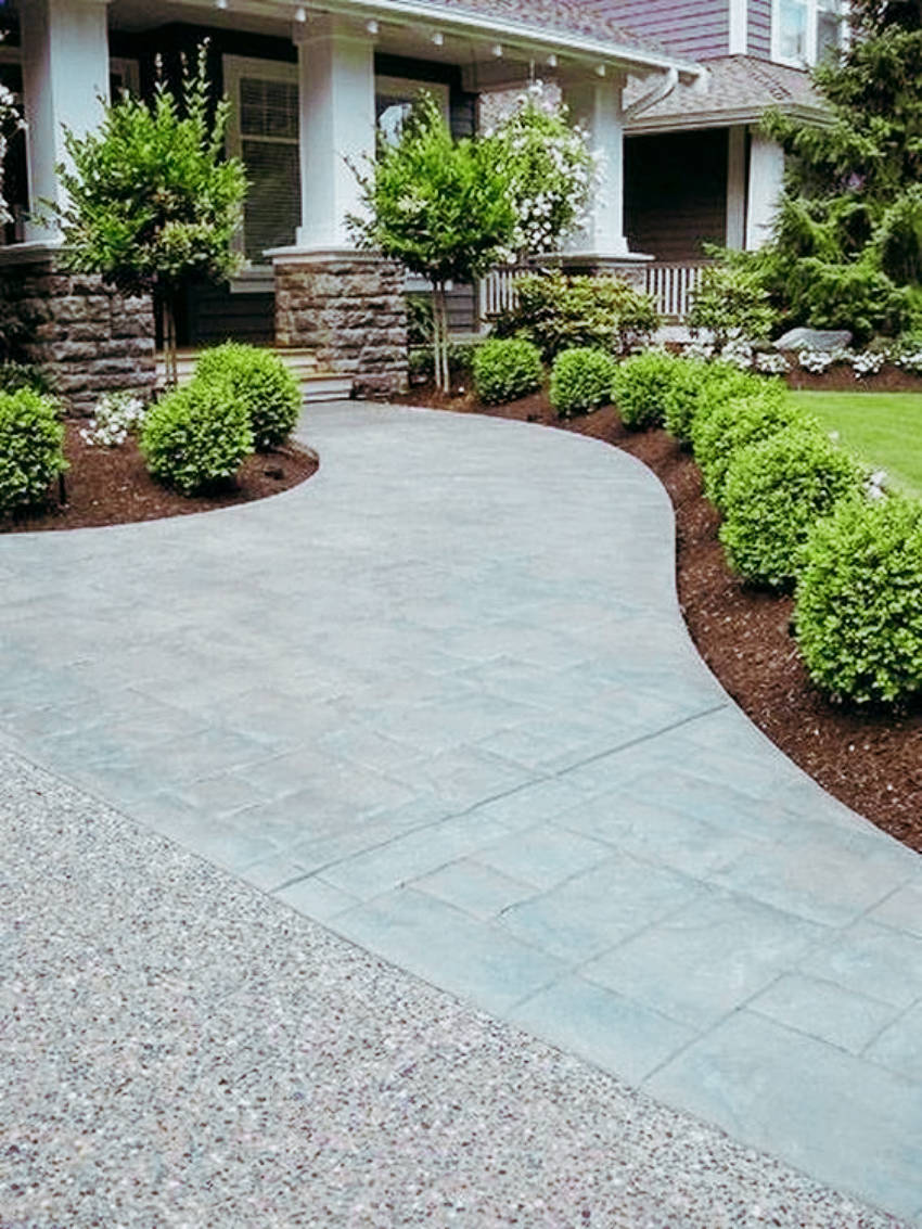 A concrete driveway adds major curb appeal to your home!