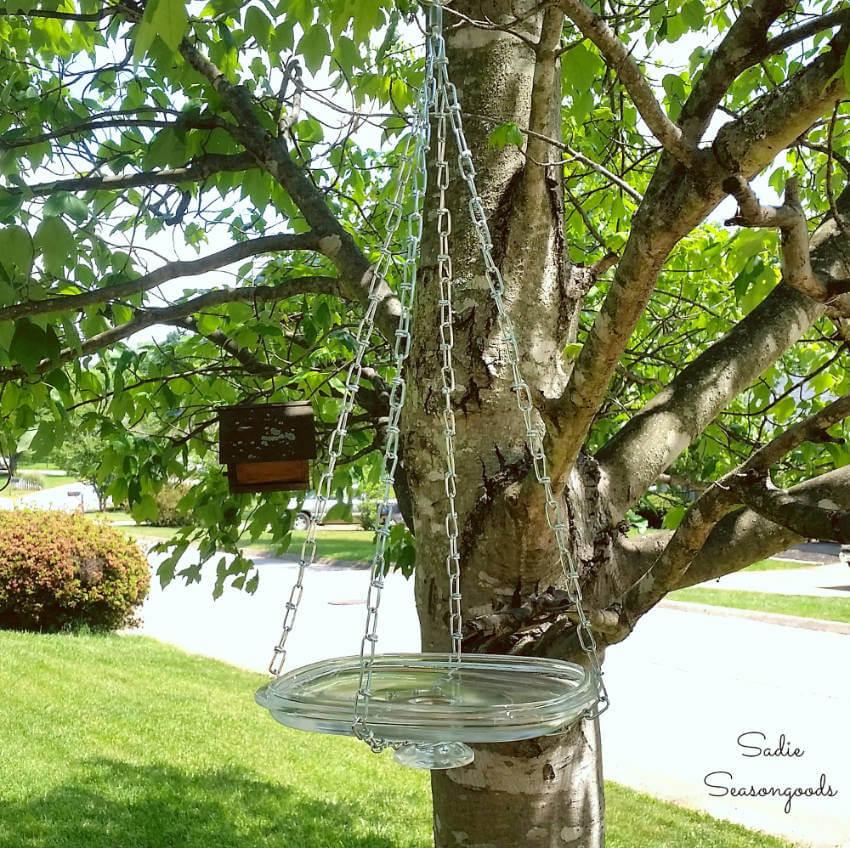 Use a casserole dish lid to DIY this bird bath.