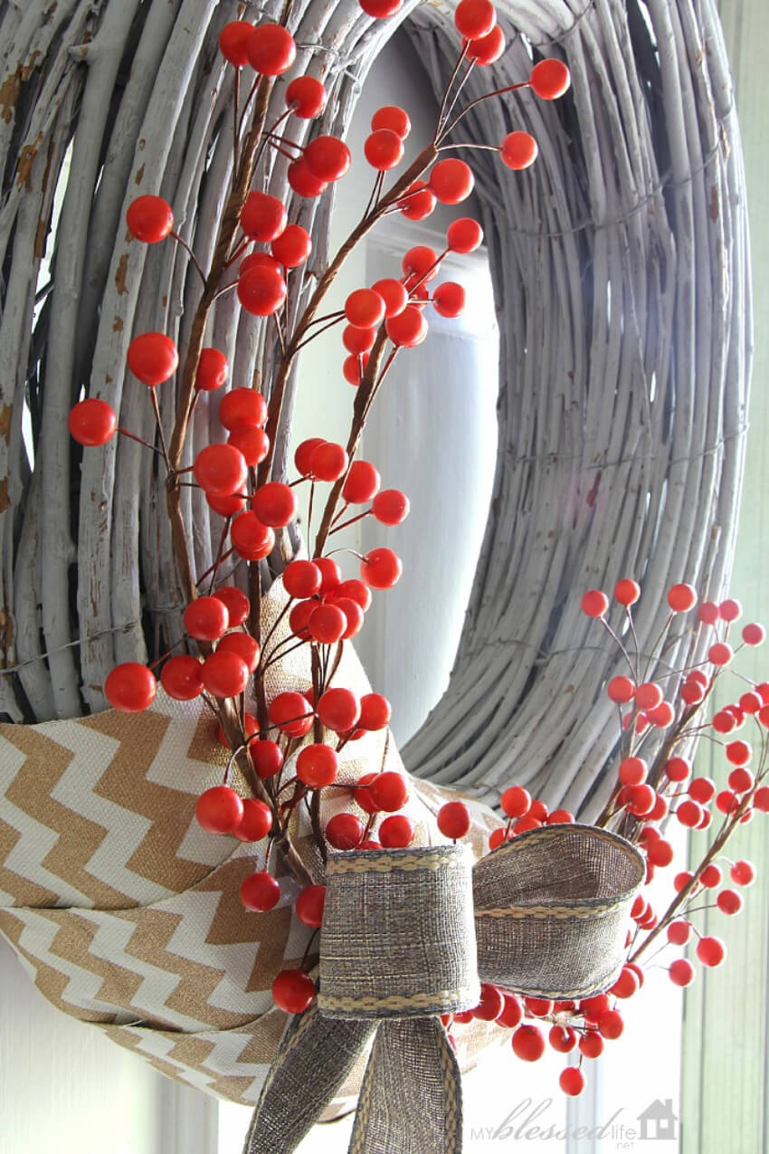 A wreath with berries adds a hint of color to your front door!