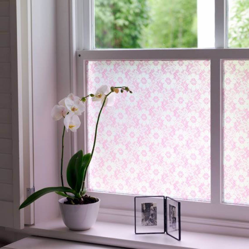 Pink lace for window decor.