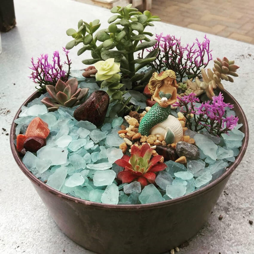 Succulents add a modern twist to the mermaid garden!