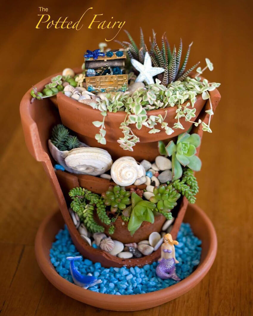 A mermaid garden is a great way to repurpose those old terra-cotta pots!