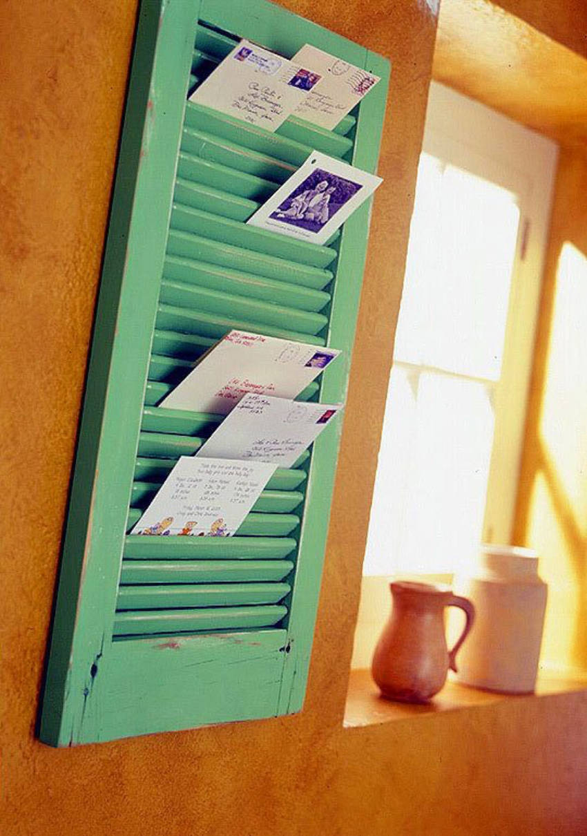 Use an old window to store papers and documents.