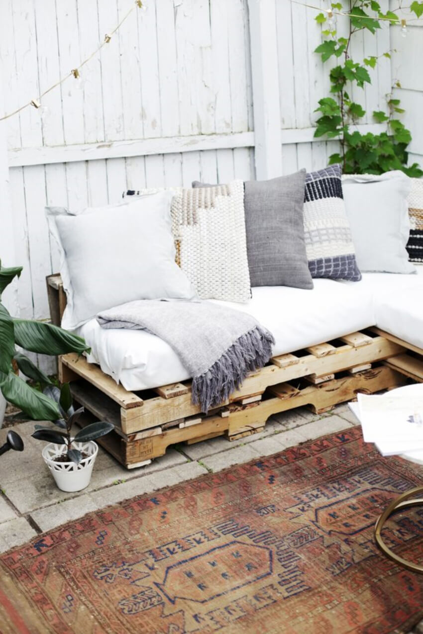 Pallet couch is simple to put together and creates a comfy place to hangout outdoors.