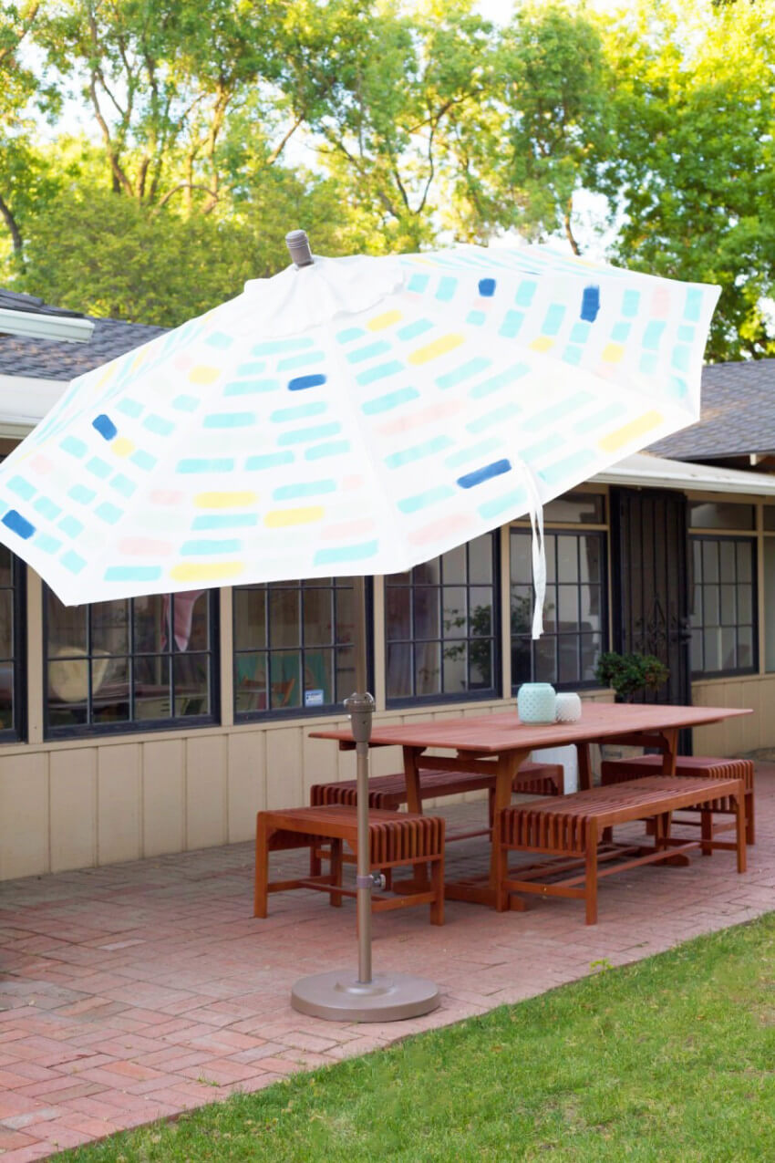A painted patio umbrella will bring charm to your outdoor decor.