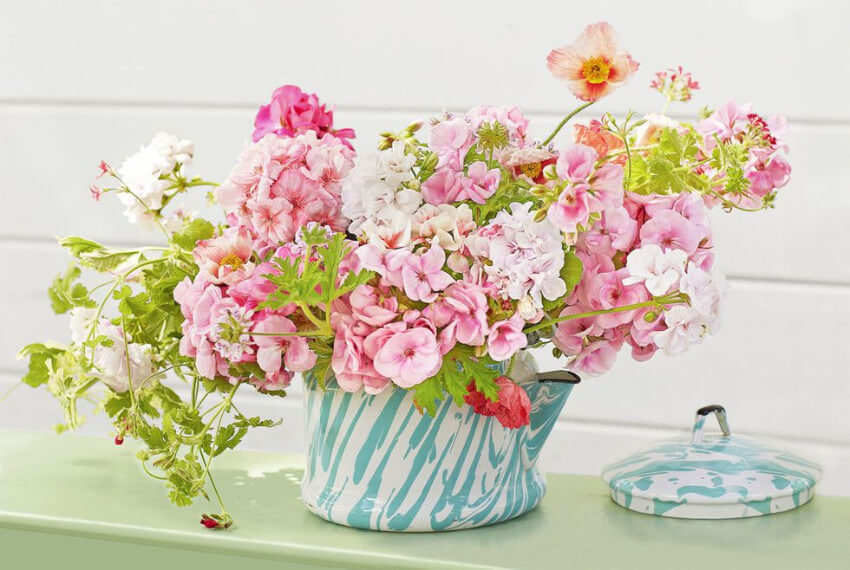 A tea kettle will make your centerpiece even more adorable!