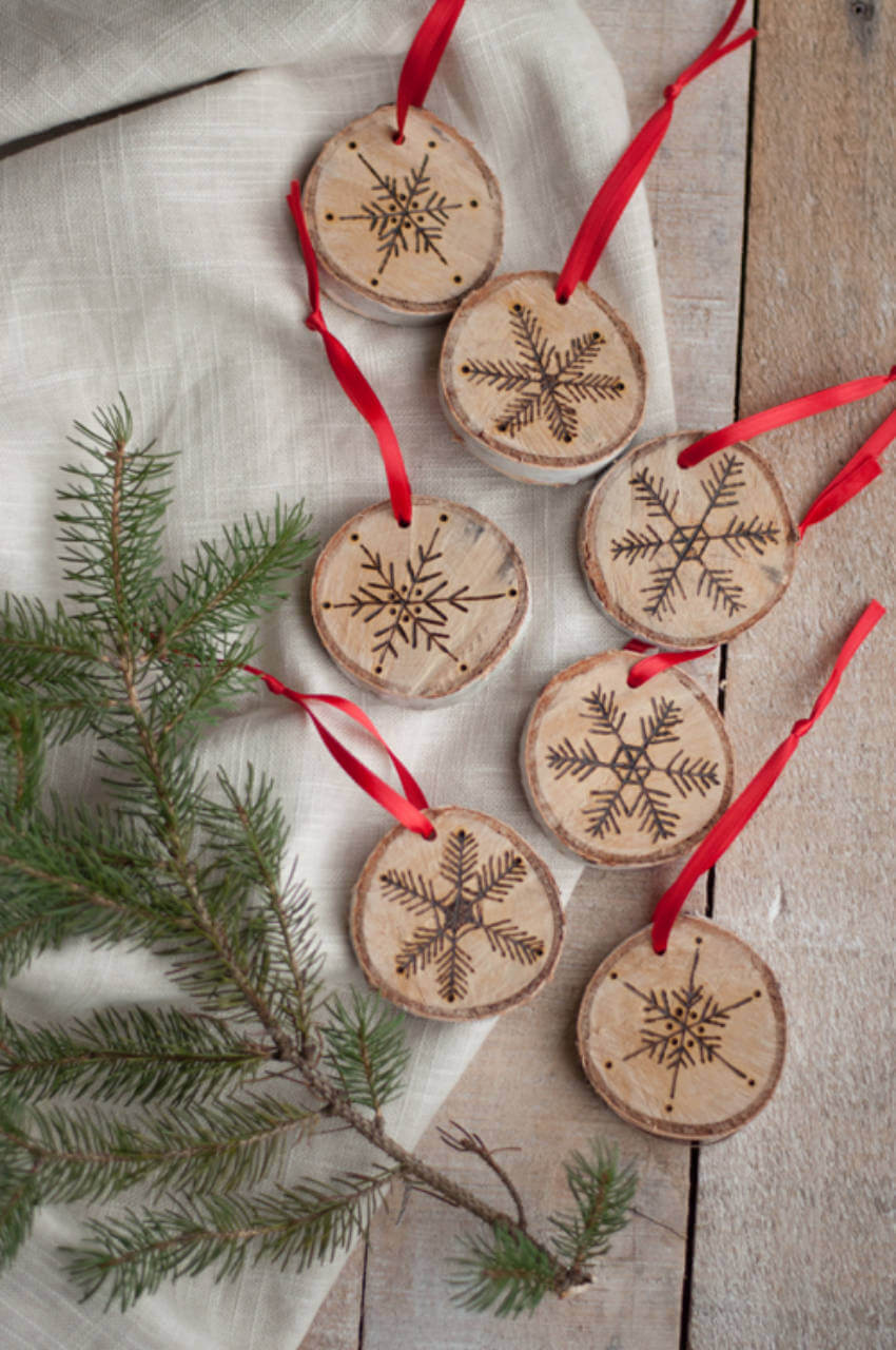 Your holiday ornaments can get way more interesting with a wood burning tool.