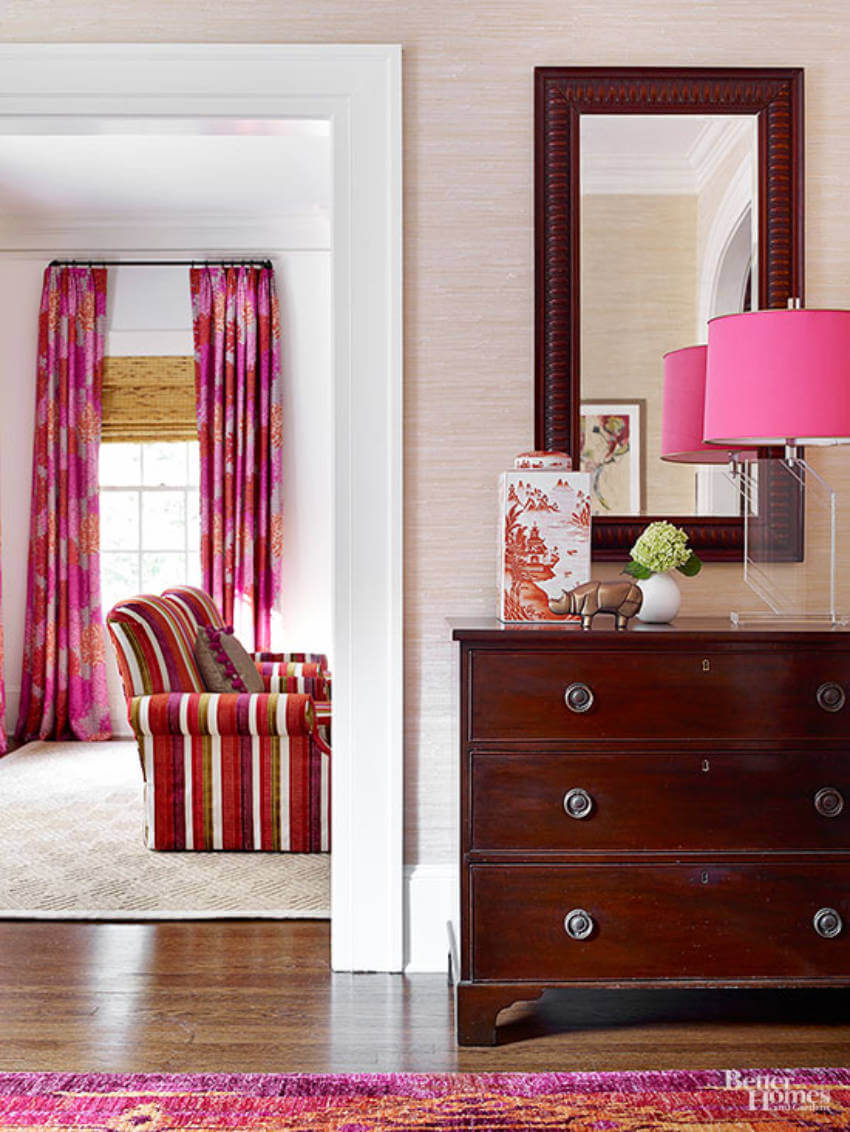 The pink pattern shows in the lamp, rug, couch and curtains!