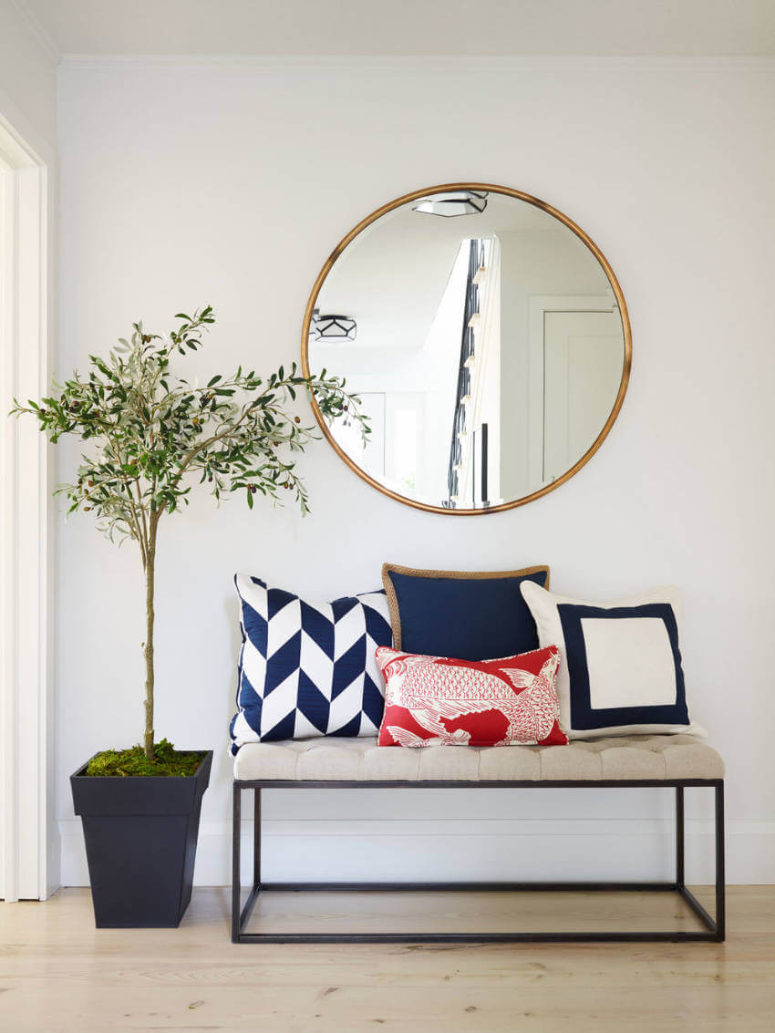 If you struggle with looking at a small entryway, a mirror is the way to go!