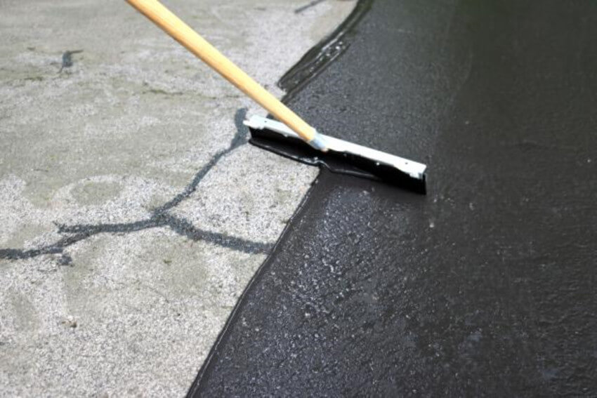 Repairing driveway cracks is really important to prevent further damage during winter.