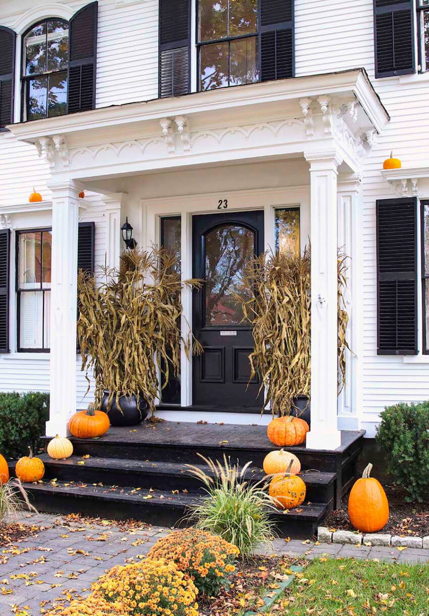 Corn stalks bring a Halloween-ish vibe to your front porch.