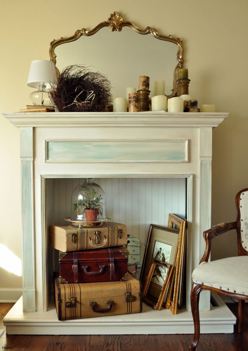 Stacked suitcases can be a great fireplace decoration!