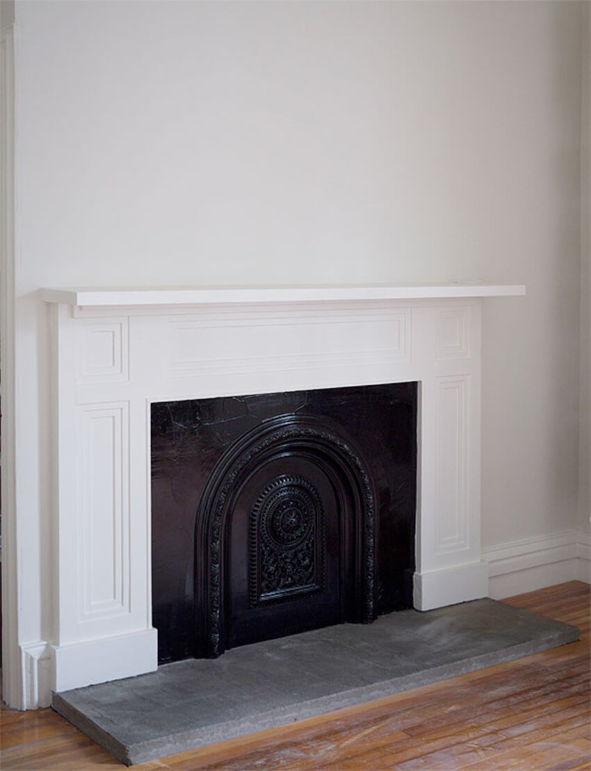 An antique summer cover can create the illusion of a real fireplace!