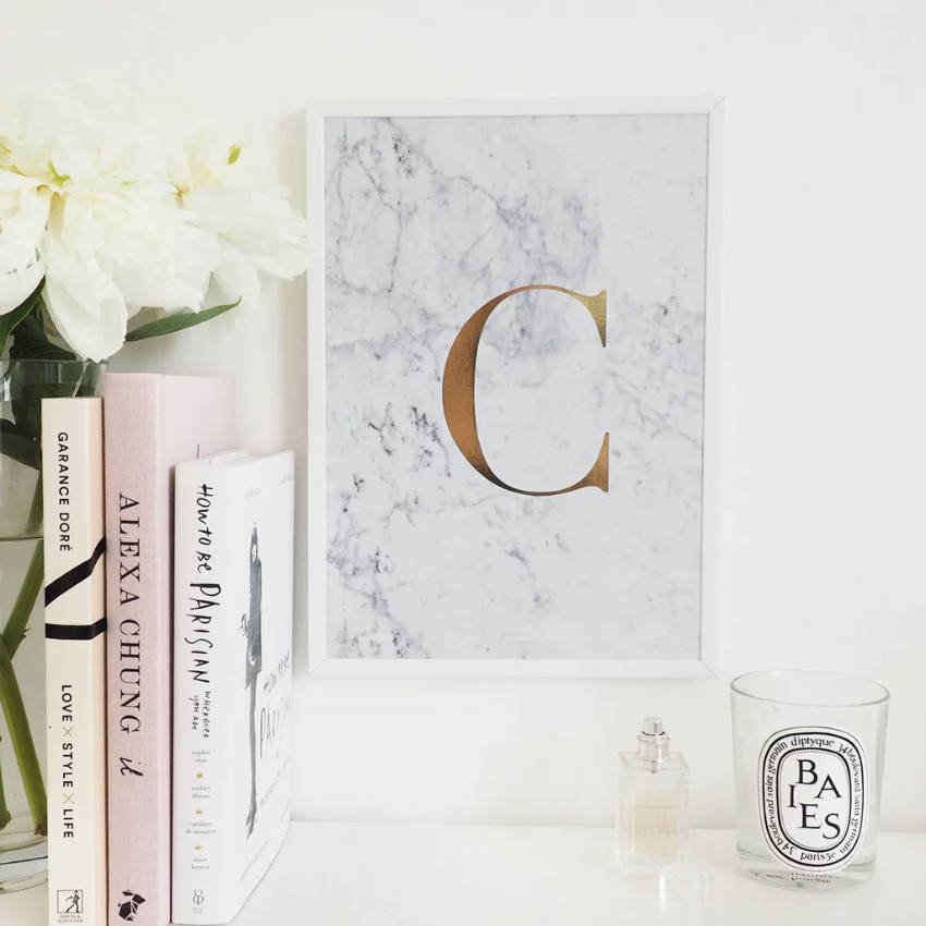 Use a simple frame to leave the monogram as the focal point.