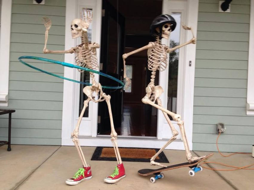 Just two skeletons fooling around with some toys!