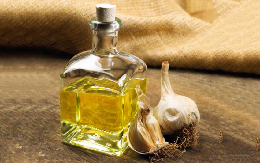 You can use garlic essential oil as well as have a garlic plant itself!
