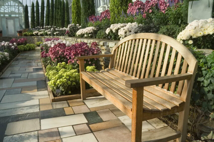A bench in the middle of your hardscape will help enjoy it more.