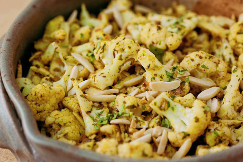 Steamed cauliflower with curry butter.