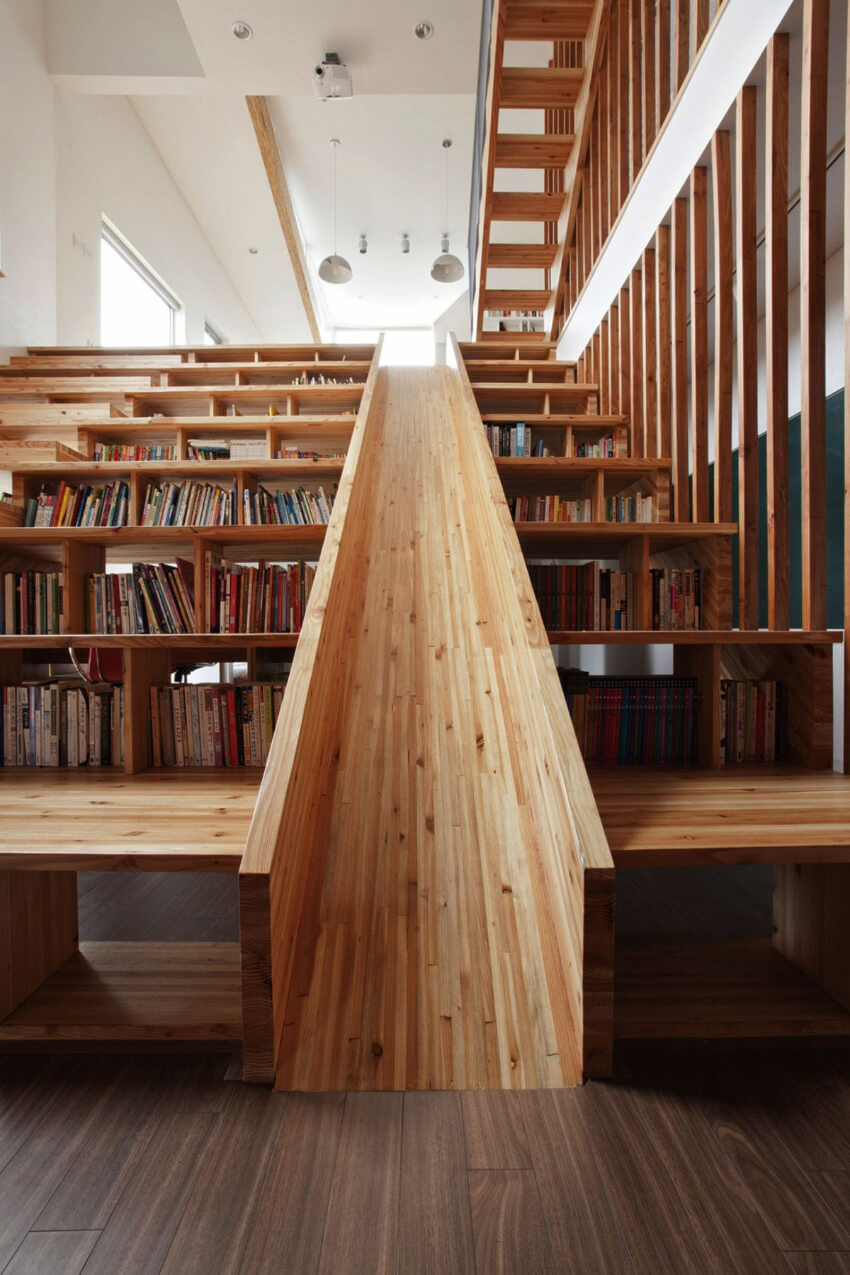 This slide is an amazing combination of stairs and bookshelf too.