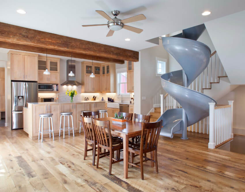 The slide is a great addition to this rustic-style home.