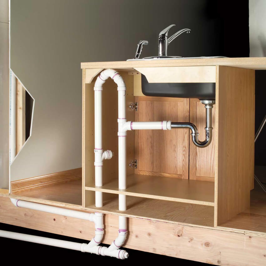 Keep cabinet doors open so warm air can reach the pipes too.