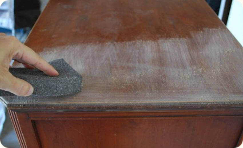 Use a tack cloth after sanding to remove any dust that may build up!