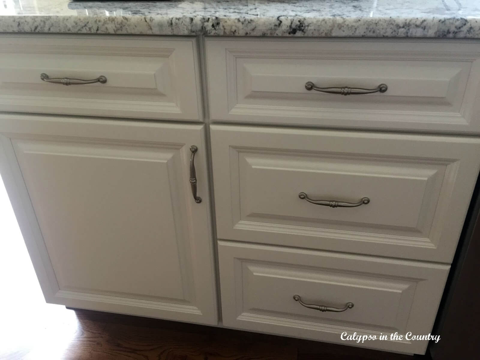 Kitchen cabinets and their hardware can both be upgraded for cheap