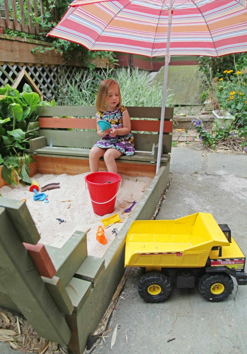 Sandbox with bench seating to guarantee a good time.