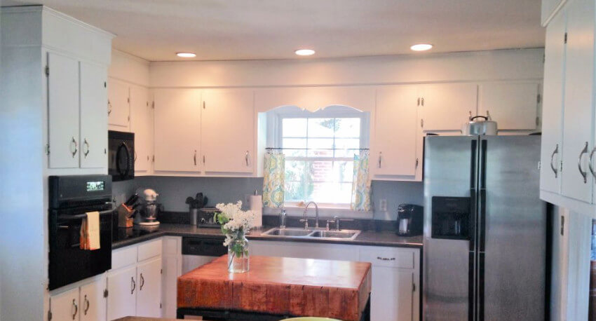 With new brighter cabinets, this kitchen looks brighter, cleaner and lighter.