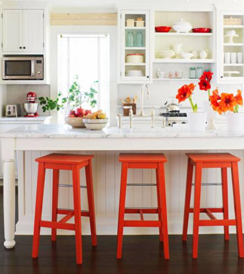 Make use of a neutral looking kitchen to accent bold colors.