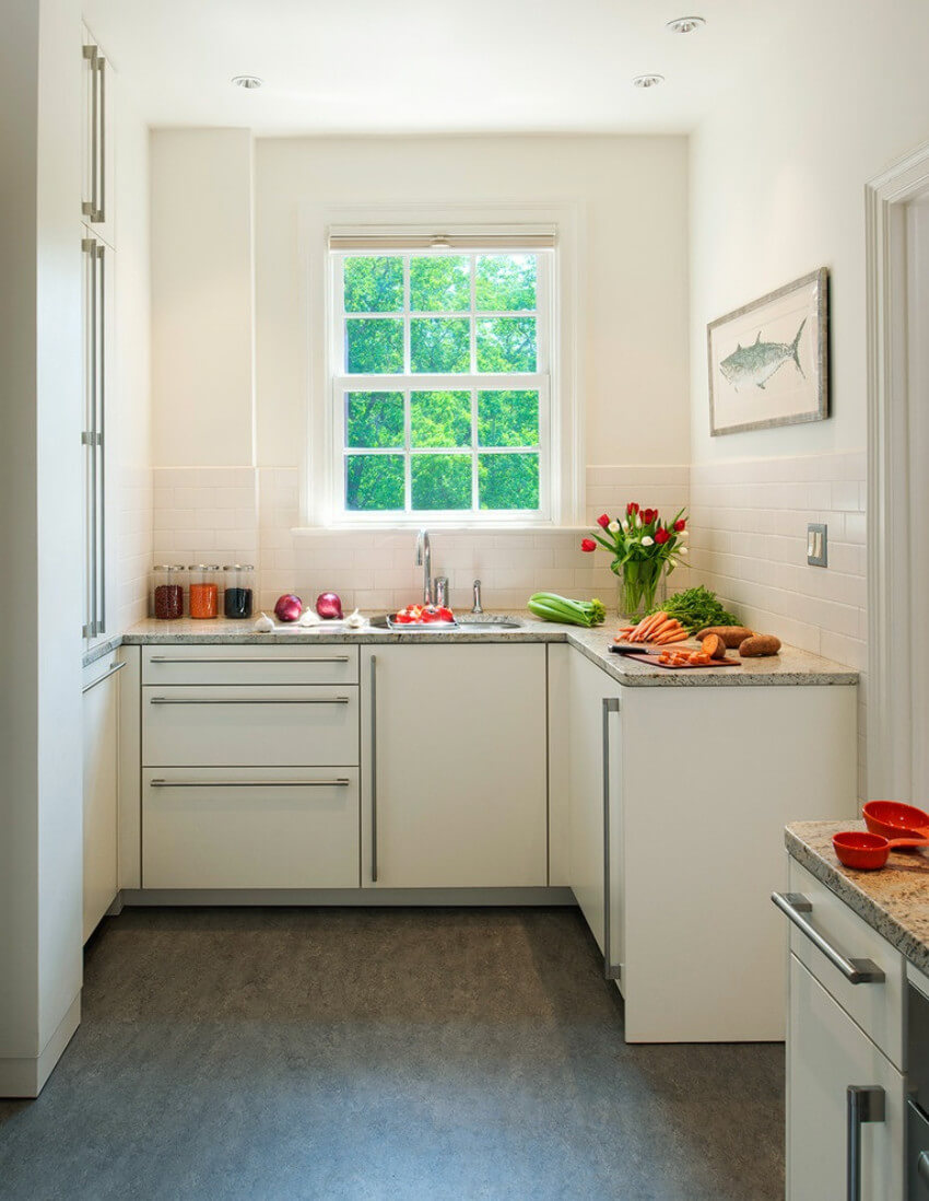 A small kitchen can look much bigger without hanging cabinets.