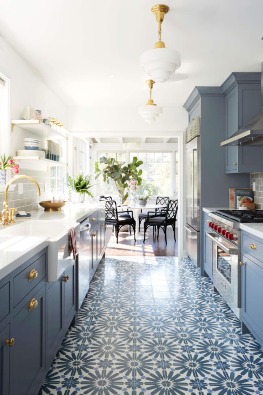 It's a smart idea to use different flooring to define the kitchen area.