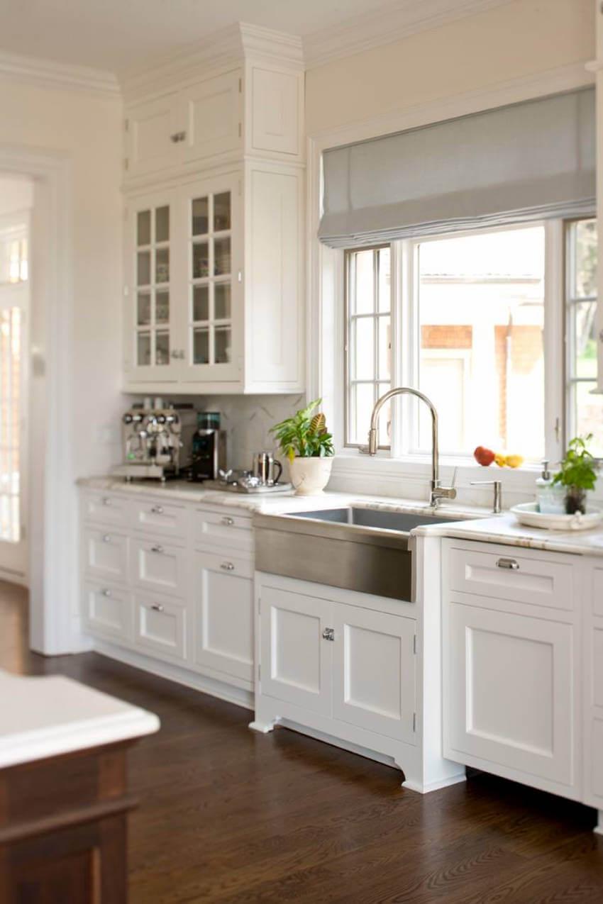 Darker floors add elegance to a kitchen.