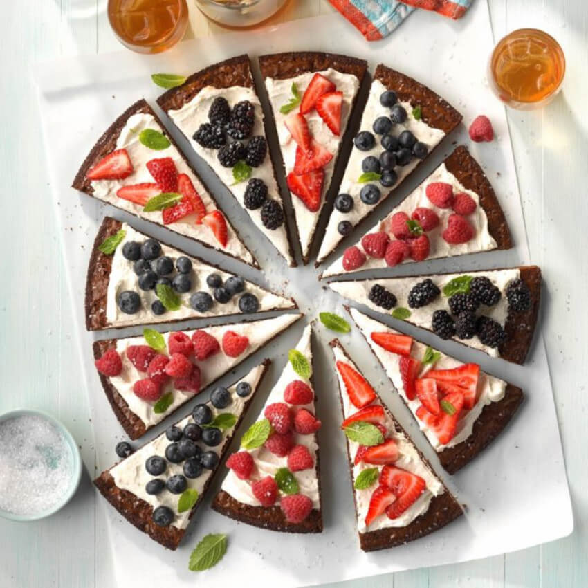 A brownie topped with fruits is the perfect dessert.
