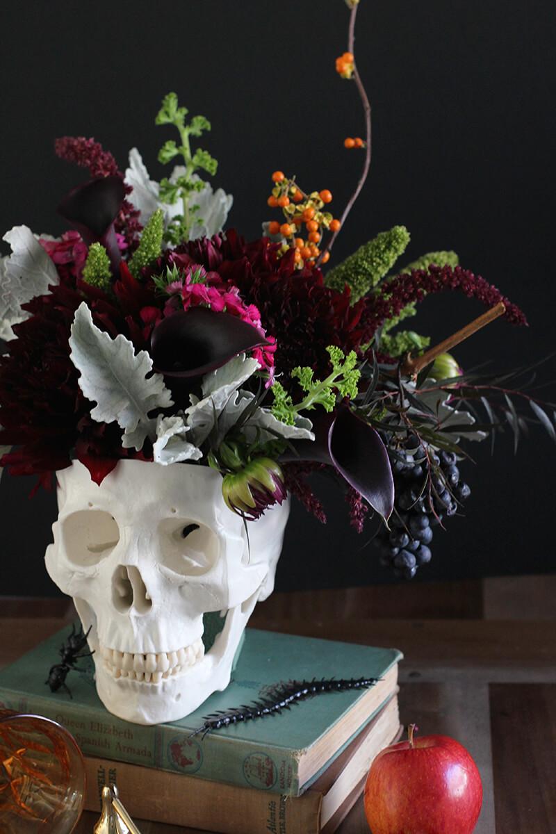 The best way to honor the dead. By making little flower pots in model skulls.