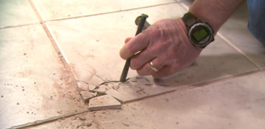 Repairing a cracked tile is something a handyman can help you with.