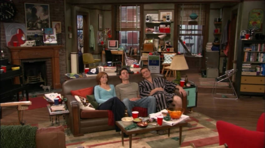 Ted Mosby's apartment. The characters are, from left to right, Lilly, Ted, and Marshall.