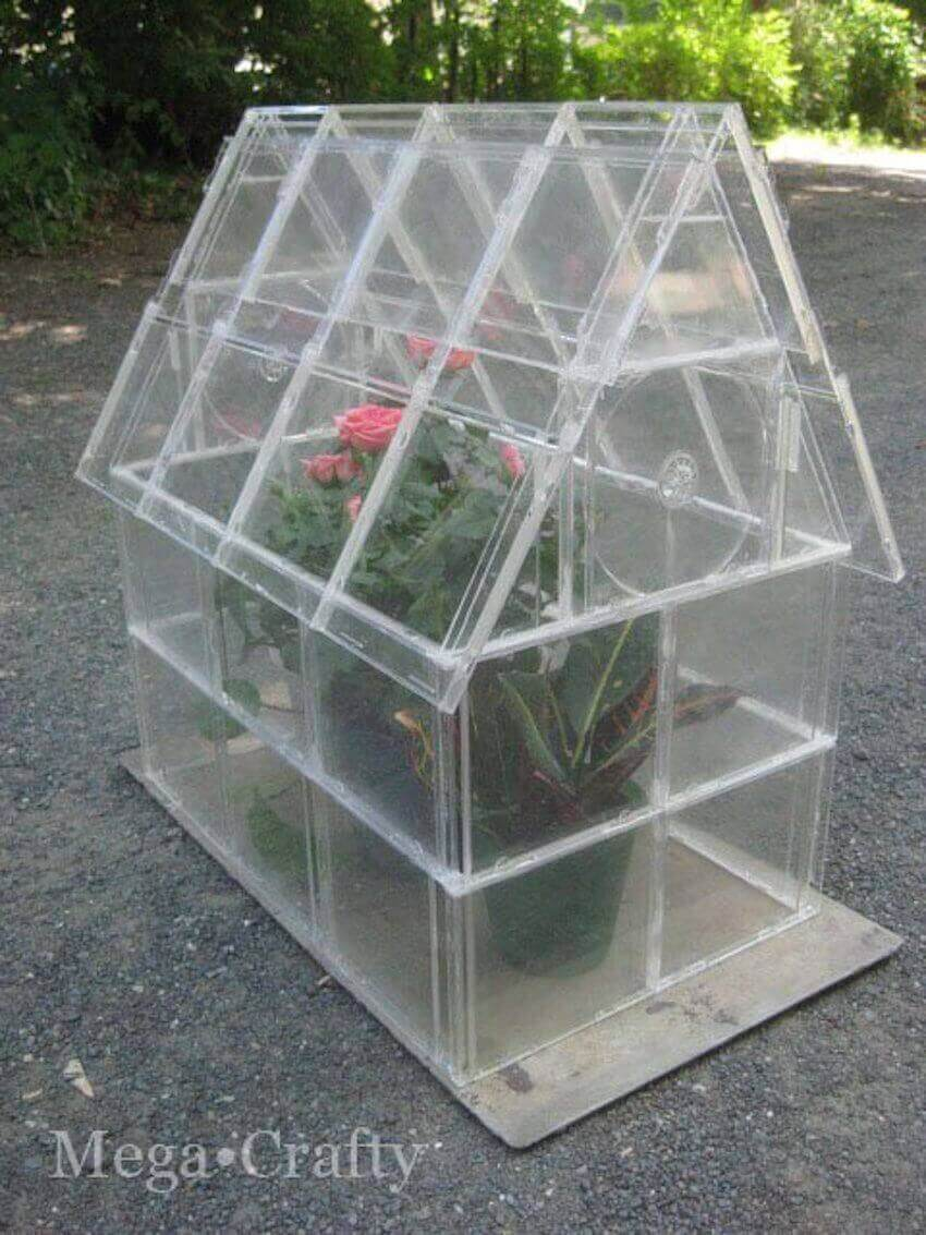 Glass DIY: Using clear CD cases is a very creative idea for crafting a small greenhouse.