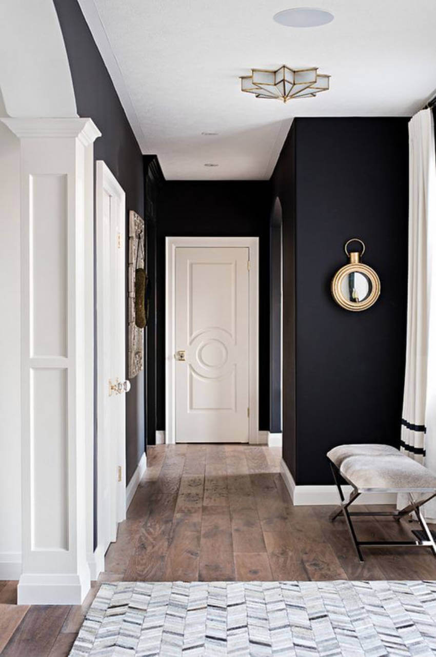 The hallway can be a great way to make a statement with black walls in your home!