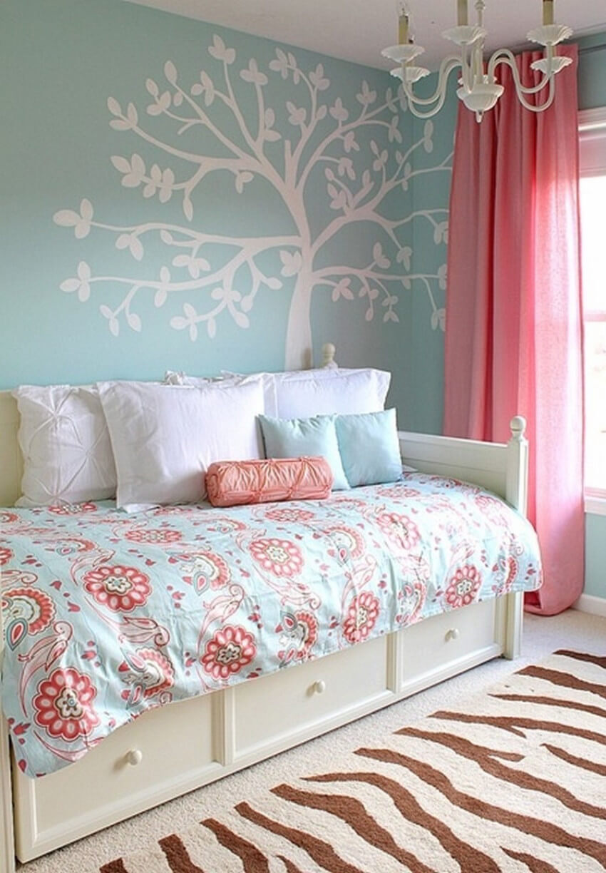 Using floral bedding with bright colors is perfect for a happy room.