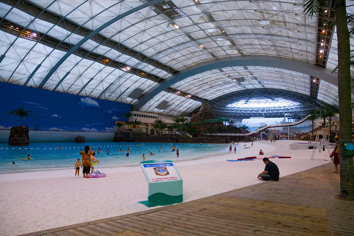 An gigantic indoor swimming pool and beach
