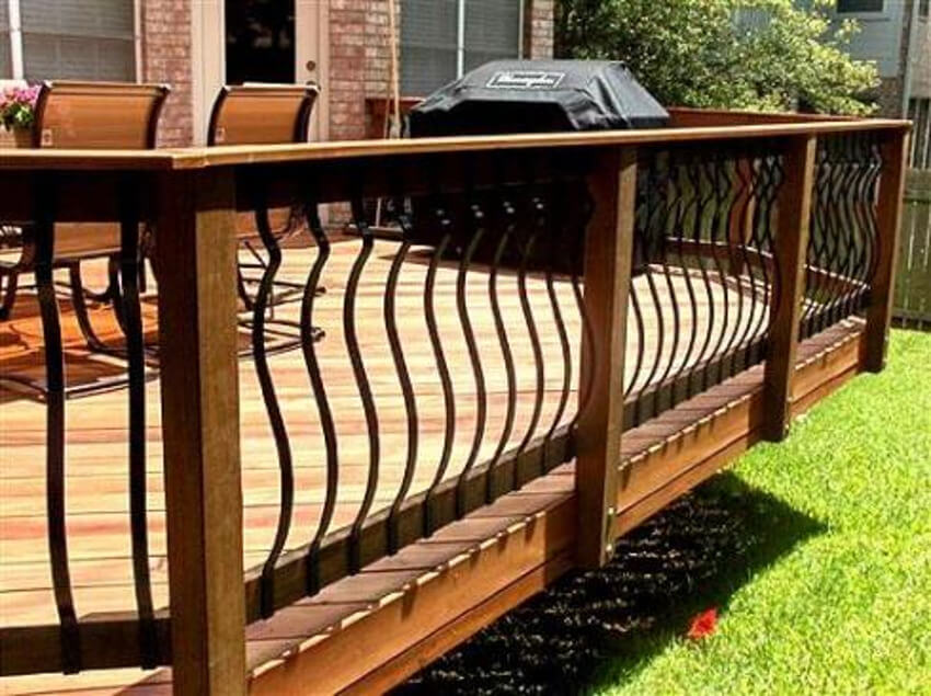This curvy iron railing is great for keeping your deck simple and stylish.