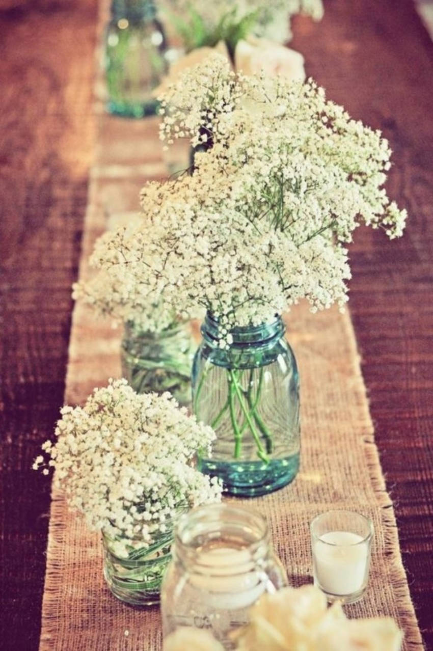 Mason jars are perfect to hold flowers on your dinner party!