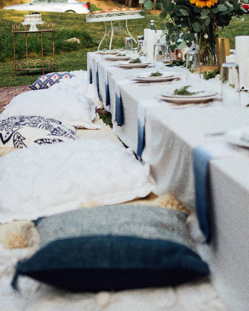 Rugs and pillows are perfect for an outdoor dinner party