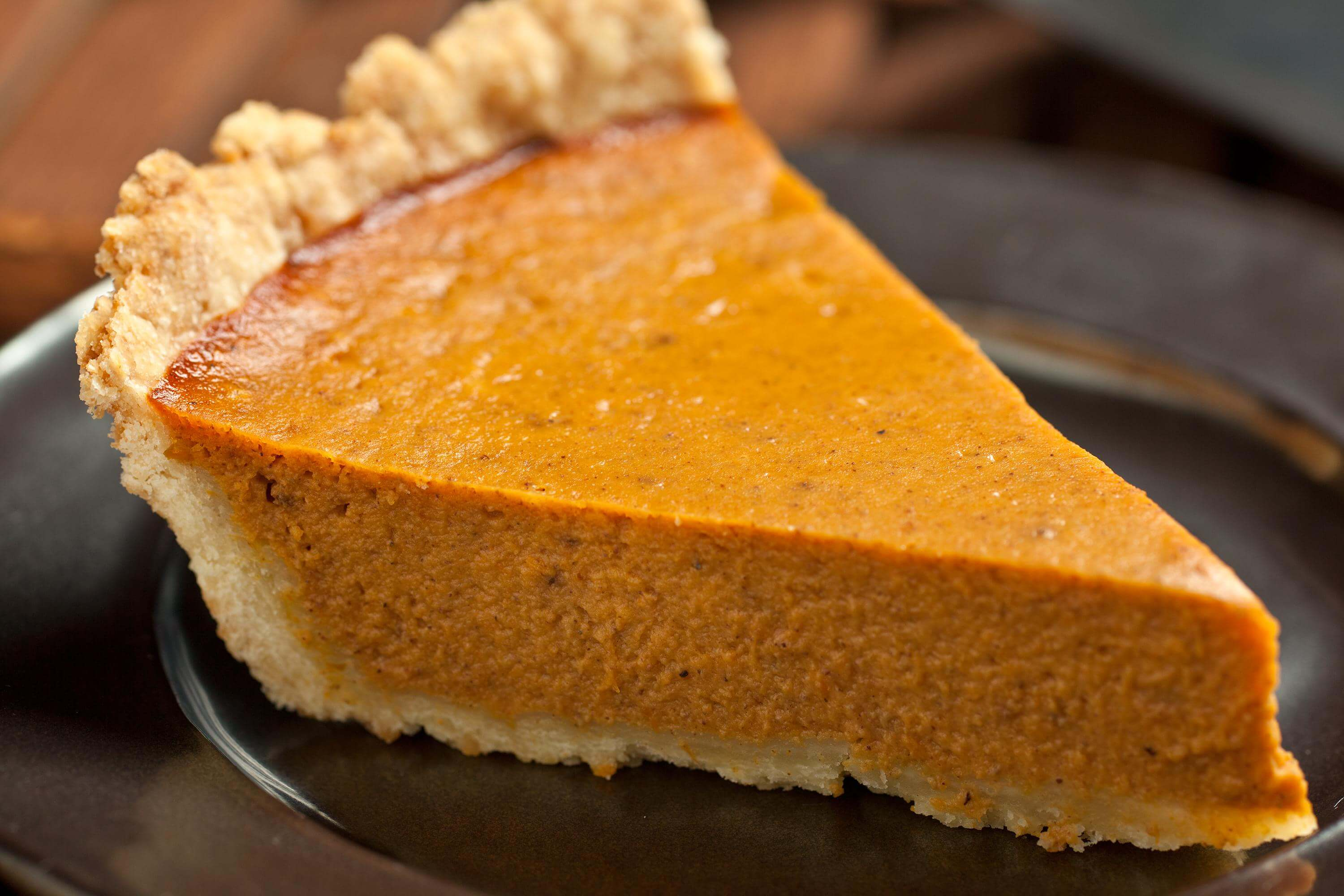 A humble slice of pumpkin pie. Top with whip cream!